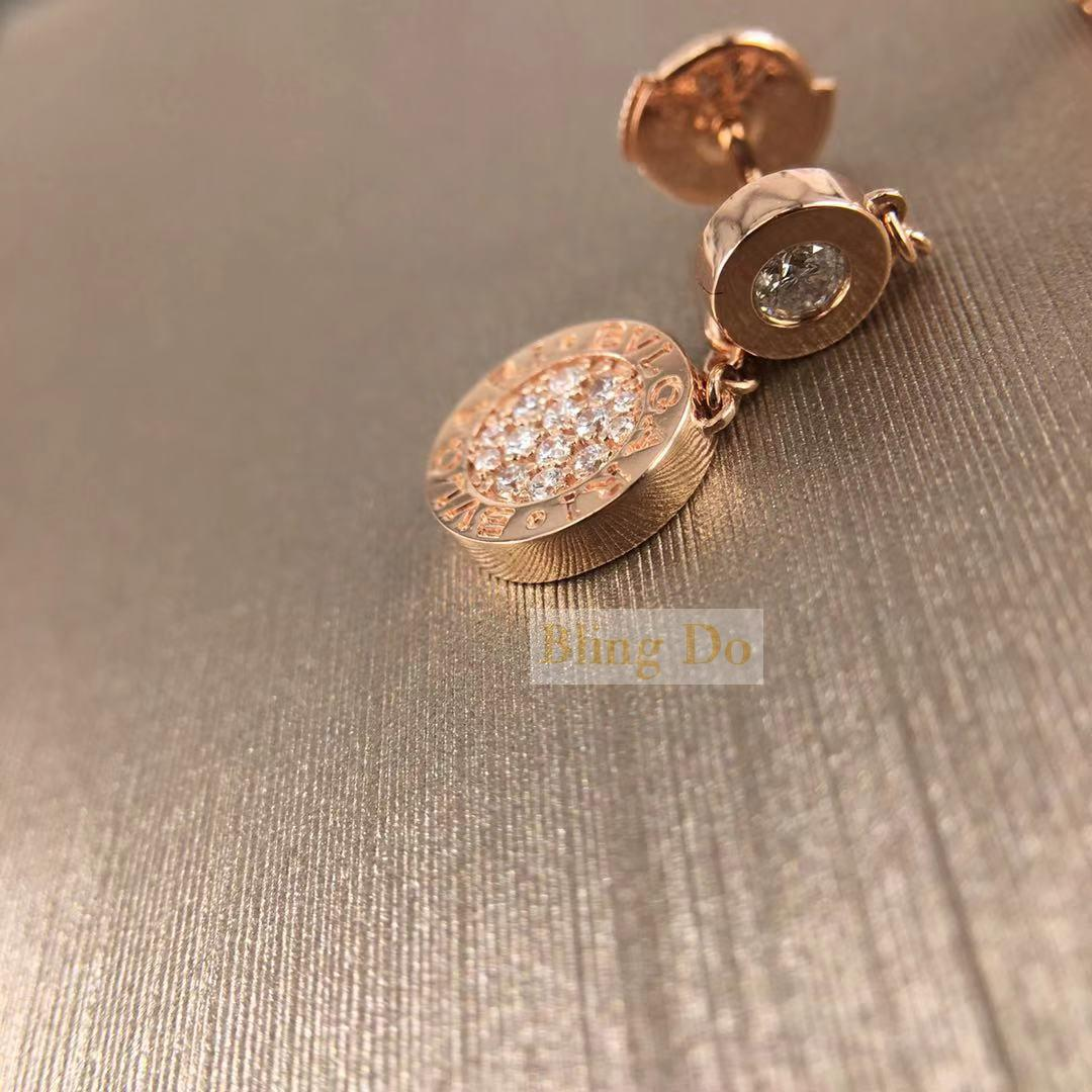 BVLGARI 18 kt rose gold earrings set with pave diamonds