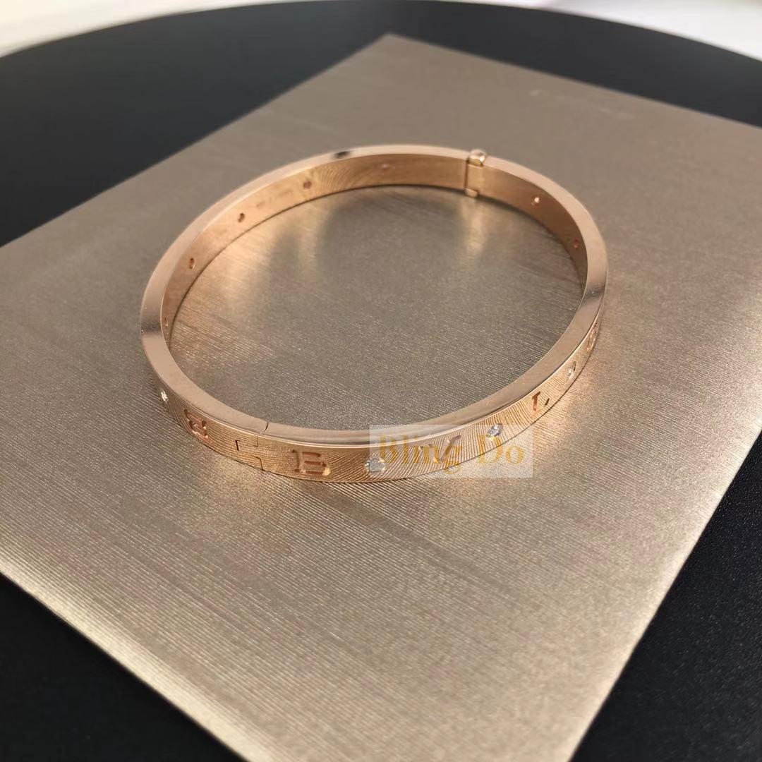 BVLGARI BVLGARI 18 kt rose gold bangle bracelet set with twelve diamond