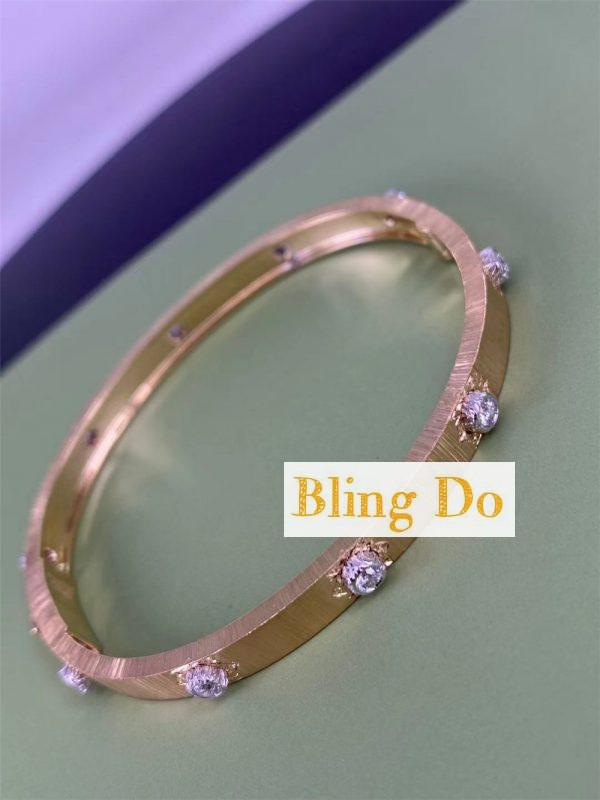 Buccellati Macri Classica Bangle Bracelet in yellow gold with white gold bezels set with diamonds
